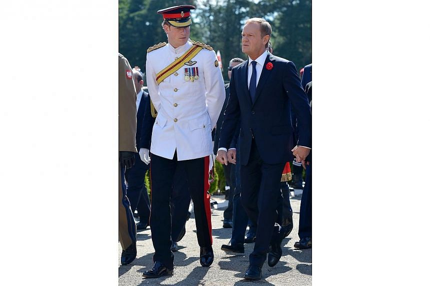 Polish Prime Minister Donald Tusk (right) with Britain's Prince Harry (left) arrive for the official ceremony marking the 70th anniversary of the Battle of Monte Cassino, in Monte Cassino, Italy, 18 May 2014. -- PHOTO: EPA