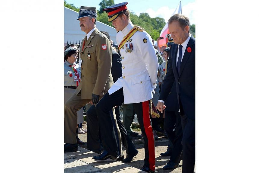 (left to right) Polish General Wieslaw Grudzinski, Britain's Prince Harry and Polish Prime Minister Donald Tusk arrive for the official ceremony marking the 70th anniversary of the Battle of Monte Cassino, in Monte Cassino, Italy, 18 May 2014. -- PHO