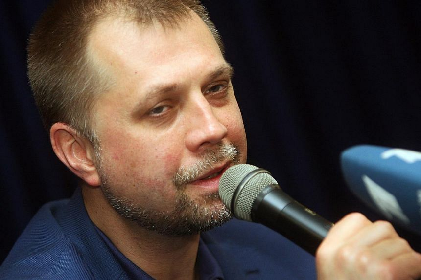 """Aleksandr Borodai, the self-proclaimed """"prime minister"""" of the pro-Russian separatists' self-declared """"People's Republic of Donetsk"""" speaks to media during a press conference in the eastern Ukrainian city of Donetsk on May 17, 2014. A mysterious """"con"""