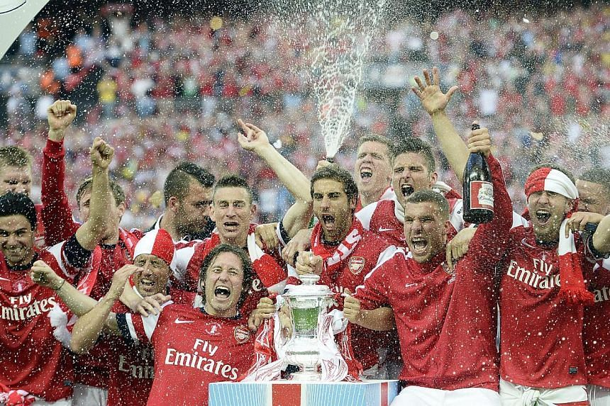 Arsenal players celebrate after winning against Hull City during the English FA cup Final at Wembley Stadium in London, Britain, on 17 May 2014. -- PHOTO: EPA