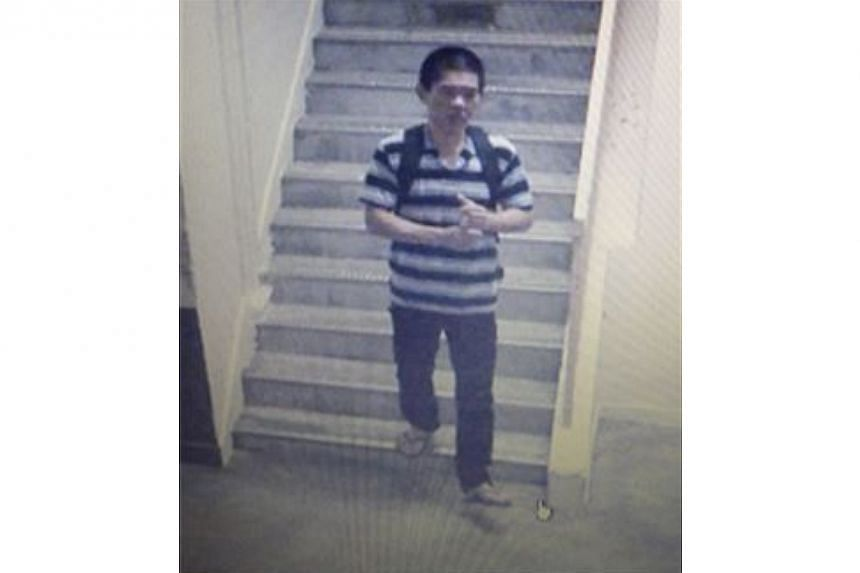 Police are looking for this person to assist with investigations into a case of attempted housebreaking along Tampines Street 21 on Feb 26, 2014. -- PHOTO: SINGAPORE POLICE FORCE