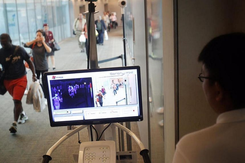 MERS screening for travellers arriving at Changi Airport Terminal 3 from Doha on May 18, 2014.Temperature screening for air travellers coming from Mers-affected Middle East countries, including the worst-hit country Saudi Arabia, started on Sun