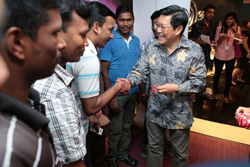 Mr Yeo Guat Kwang (right), chairman of the Migrant Workers' Centre, meets foreign workers during its May Day celebration on May 18, 2014. -- PHOTO: NTUC