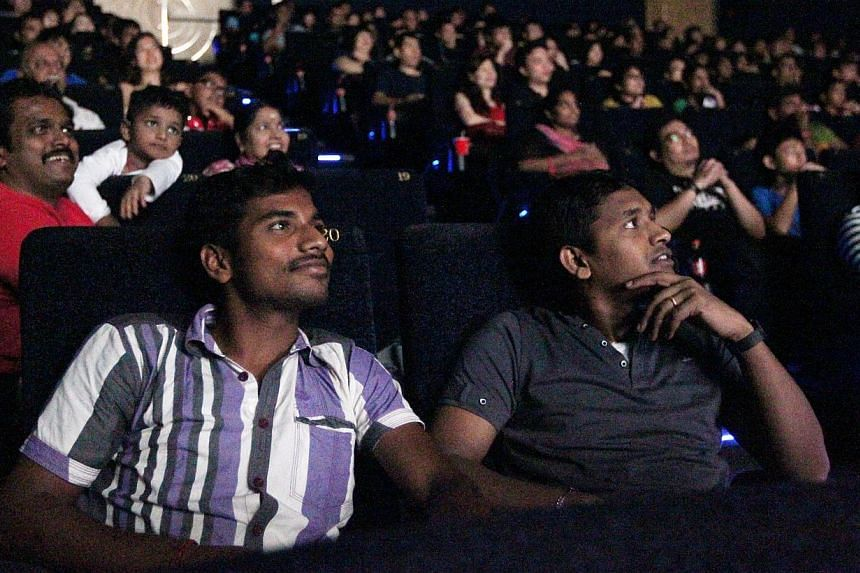 About 10,500 foreign workers enjoyed free movies on Sunday, May 18, 2014 as part of the Labour Movement's May Day celebrations. -- ST PHOTO:SEAH KWANG PENG