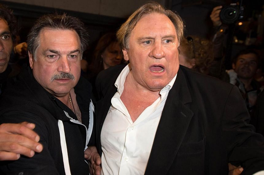 "French actor Gerard Depardieu arrives to attend the screening of the film ""Welcome to New York"" on the sidelines of the 67th edition of the Cannes Film Festival in Cannes, southern France, on May 17, 2014. -- PHOTO: AFP"