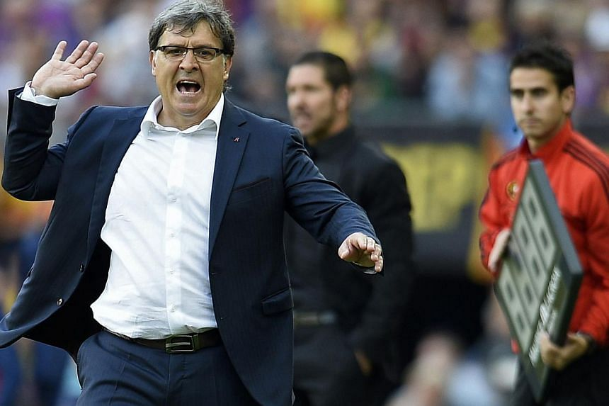 """Barcelona's Argentinian coach Gerardo """"Tata"""" Martino reacts during the Spanish league football match FC Barcelona vs Club Atletico de Madrid at the Camp Nou stadium in Barcelona on May 17, 2014. -- PHOTO: AFP"""