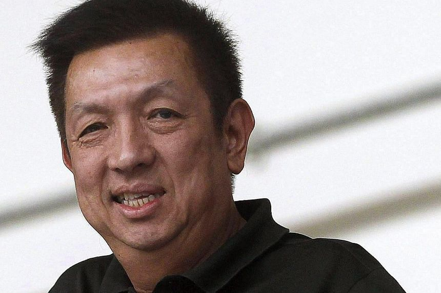 A file picture dated 21 May 2013 shows Singaporean billionaire Peter Lim during an Atletico Madrid exhibition soccer match at Jalan Besar Stadium in Singapore. Lim took over Spanish soccer team Valencia CF's main parcel of shares after the board of m