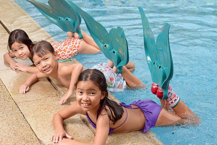 MerFins give (from Left) Lucy Meyer, five, and her friends Stan Rowe, five, and Zoe Rowe, seven, the thrill of pretending they are mermaids.