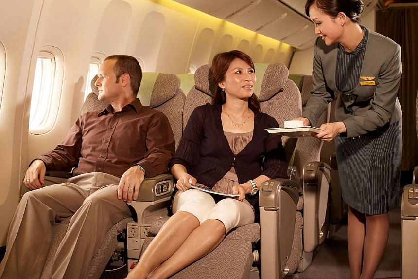 Premium service is one of the perks of premium economy class, available on a number of airlines. Singapore Airlines will introduce it next year. -- PHOTO: EVA AIR