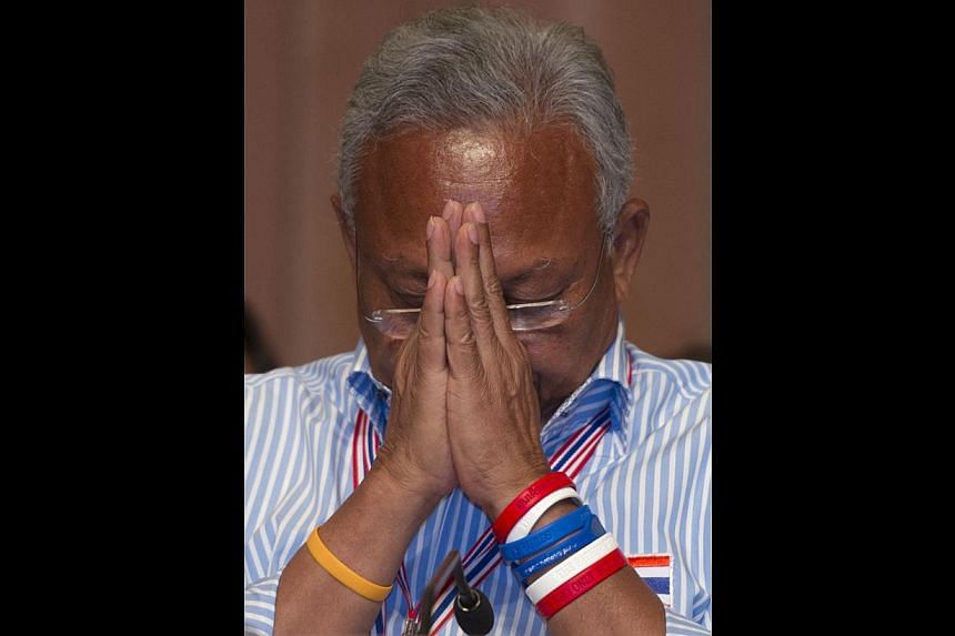 Thai anti-government protest leader Suthep Thaugsuban greeting his supporters at a meeting yesterday.