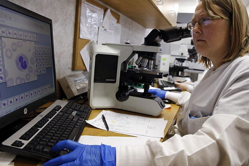 Shay Wilinski works in the Microbiology Lab at Community Hospital, where a patient with the first confirmed U.S. case of Middle East Respiratory Syndrome is in isolation, in Munster, Indiana, May 5, 2014. -- FILE PHOTO: REUTERS
