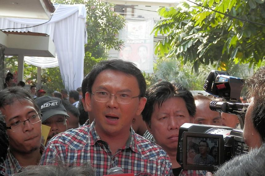 File picture of Mr Basuki Tjahaja Purnama, better known as Ahok, speaking to reporters in central Jakarta. Ahok is the first ethnic Chinese to be Jakarta acting governor. --PHOTO: SPH