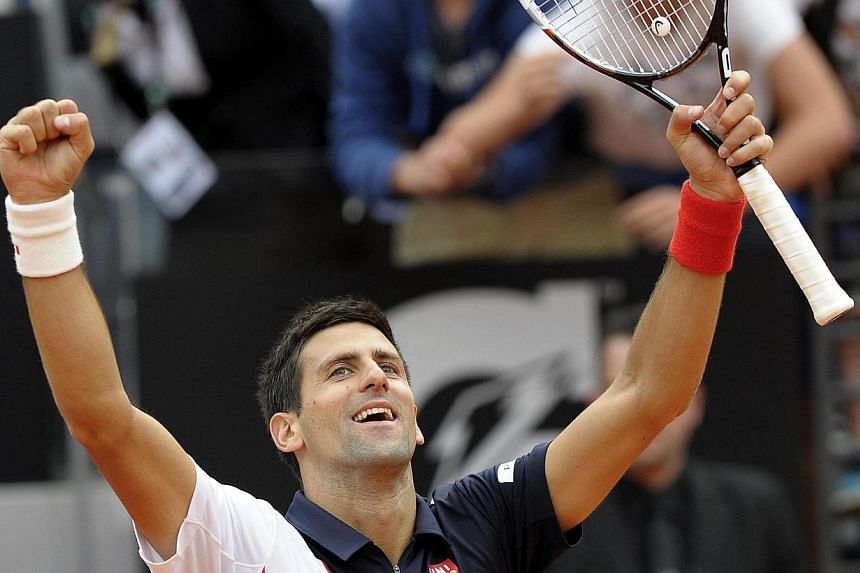Serbian tennis player Novak Djokovic celebrates after beating Spanish tennis player Rafael Nadal in their final match of the Italian Open tennis tournament at Foro Italico in Rome, Italy, on 18 May 2014. -- PHOTO: EPA