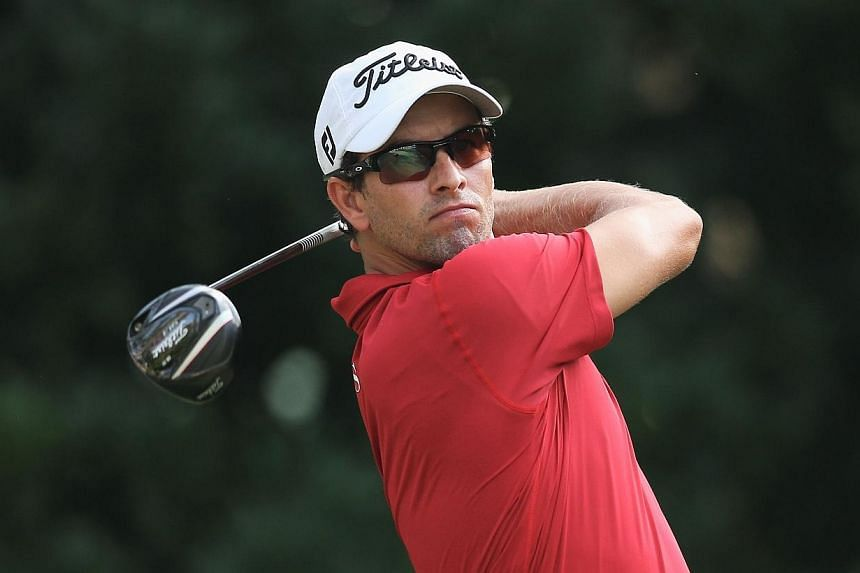 Australian Adam Scott has surpassed Tiger Woods as the No. 1 player on the official world golf rankings, seizing the top spot despite not playing this past week. -- FILE PHOTO: AFP