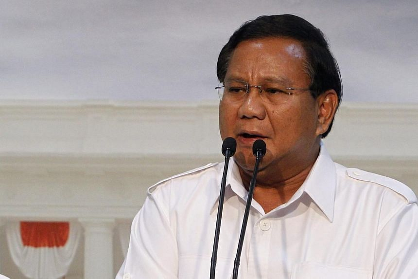 Indonesian presidential candidate and head of the Great Indonesia Movement Party (Gerindra) Prabowo Subianto talks to jornalists in Jakarta, Indonesia, on May 13, 2014. Indonesia's second largest party, Golkar, will support Mr Subianto in July's pres
