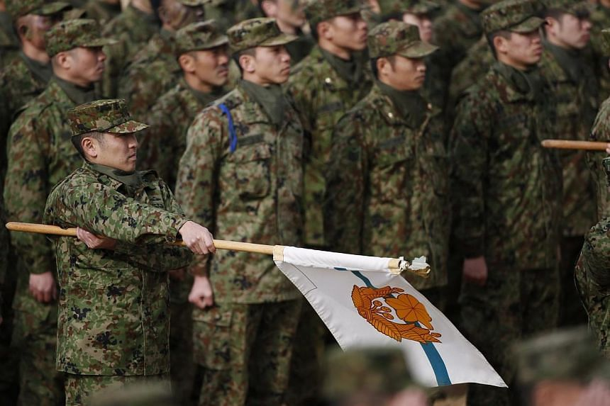 Members of Japan's Ground Self-Defense Force 1st Airborne Brigade take part in an annual new year military exercise at Narashino exercise field in Funabashi, east of Tokyo in this January 12, 2014 file photo.Japan is to establish new military o