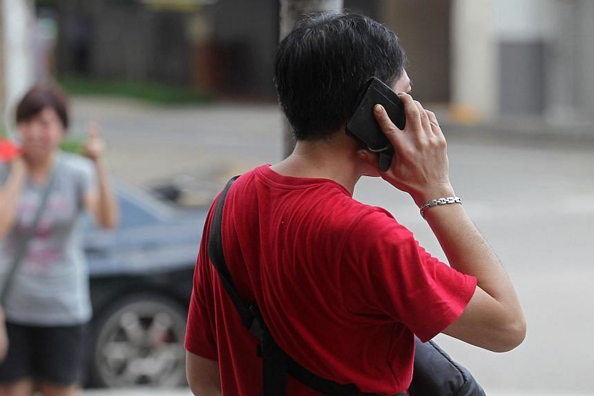 A man talking on a mobile phone.Mobile phone users on 4G plans will soon enjoy clearer phone calls and faster call connection times - though the number of supporting handsets could be limited, initially. -- ST FILE PHOTO:SEAH KWANG PENG