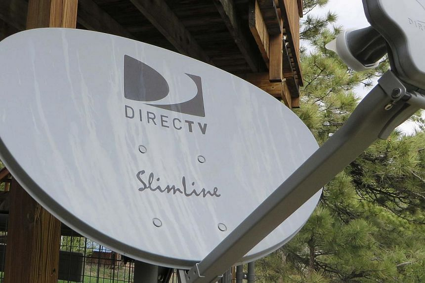 A DirecTV satellite dish is seen on a home in the mountains outside Golden, Colorado on May 18, 2014. -- PHOTO: REUTERS