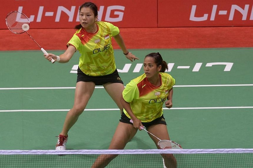 Lei Yao (top) and Shinta Mulia Sari of Singapore play a return shot to unseen Ye Na Jang and So Young Kim of Korea during their Uber Cup badminton match at The Siri Fort Stadium in New Delhi on May 18, 2014. The women's squad had gotten off to a