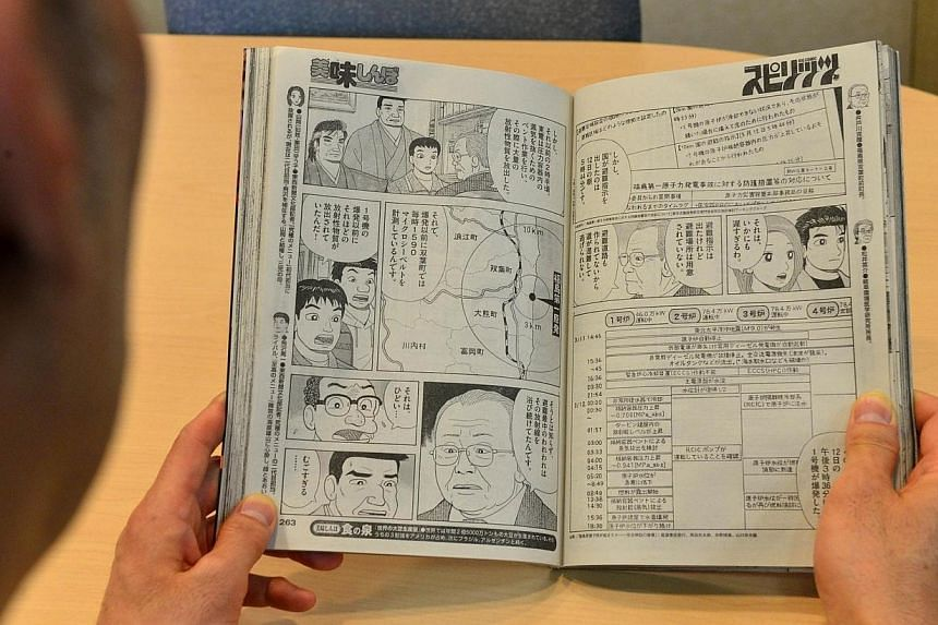 """A man reads the latest edition of Japanese comic """"Oishinbo"""" which shows an interview of former Futaba town Mayor Katsutaka Idogawa on May 12, 2014.The Japanese publisher of a comic that came under fire for linking radiation exposure at Fukushim"""