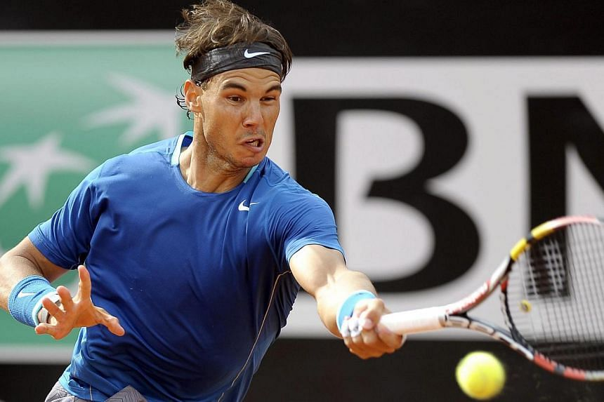 Spanish tennis player Rafael Nadal returns the ball to Serbian Novak Djokovic during their final match for the Italian Open tennis tournament at Foro Italico in Rome, Italy, on 18 May 2014. -- PHOTO: EPA
