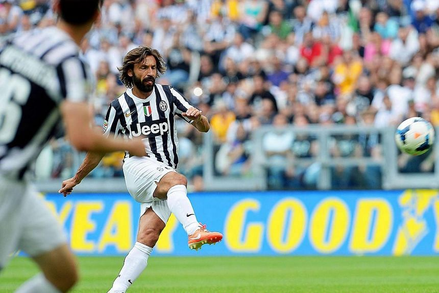 Juventus' Andrea Pirlo scores the opening goal during the Italian Serie A soccer match between Juventus FC and Cagliari Calcio at the Juventus Stadium in Turin, Italy, on 18 May 2014. -- PHOTO: EPA