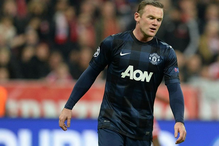 Manchester United's English striker Wayne Rooney reacts during the UEFA Champions League quarter-final second leg football match Bayern Munich vs Manchester United in Munich, southern Germany, on April 9, 2014. -- FILE PHOTO: AFP