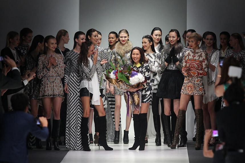 Khan's (centre) creations on show at last week's Audi Fashion Festival. -- ST PHOTO: ONG WEE JIN