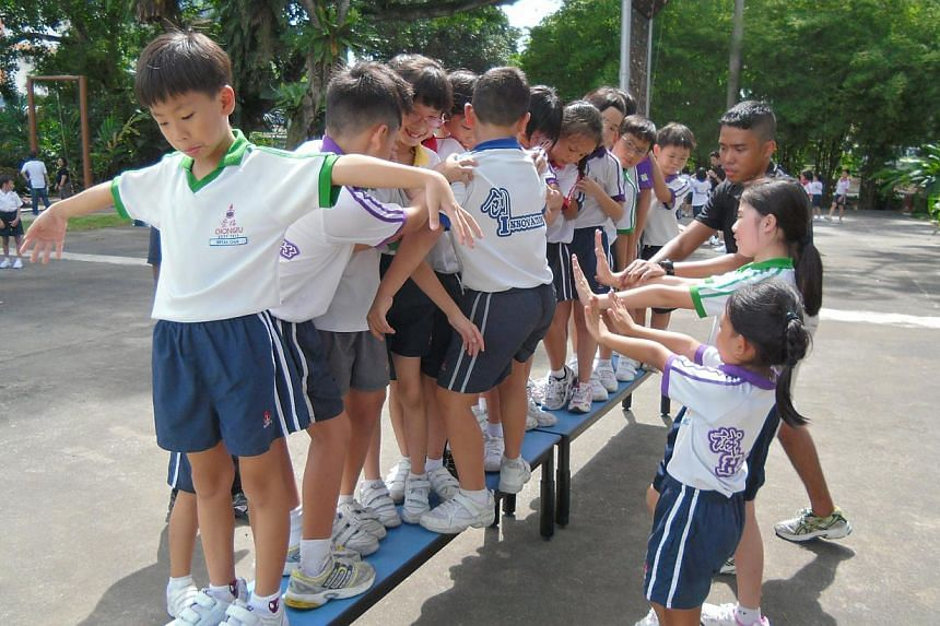 Primary 3 pupils from Chongfu School learning about teamwork through a game facilitated by an external trainer at Labrador Park last year.