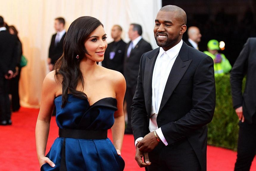 Kim Kardashian (left) and Kanye West attend the Charles James: Beyond Fashion Costume Institute Gala at the Metropolitan Museum of Art in New York City on May 5, 2014. -- FILE PHOTO: AFP