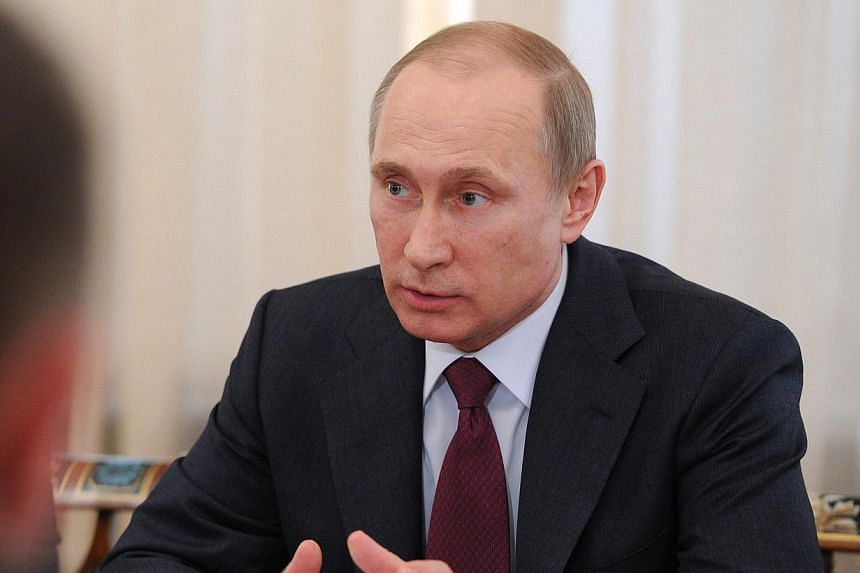 President Vladimir Putin has ordered military forces that took part in drills in three regions bordering Ukraine to return to the places where they are permanently deployed, the Interfax news agency reported on Monday. -- FILE PHOTO: AFP
