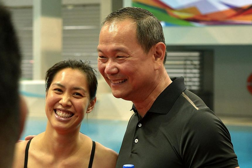 Swimming greats, Joscelin Yeo (left) and Ang Peng Siong (right) at the new OCBC Aquatic Centre located at the Sports Hub. -- ST PHOTO: KUA CHEE SIONG