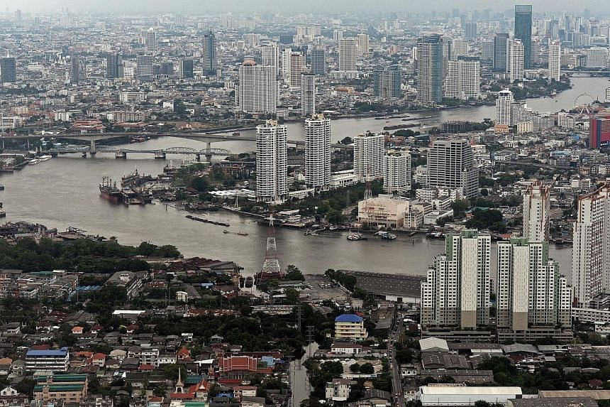 Bangkok's skyline and the Chao Phraya river pass through the Thai capital. Weak exports and faltering domestic demand hurt by months of political unrest in Bangkok has harmed the economy. -- FILE PHOTO: AFP