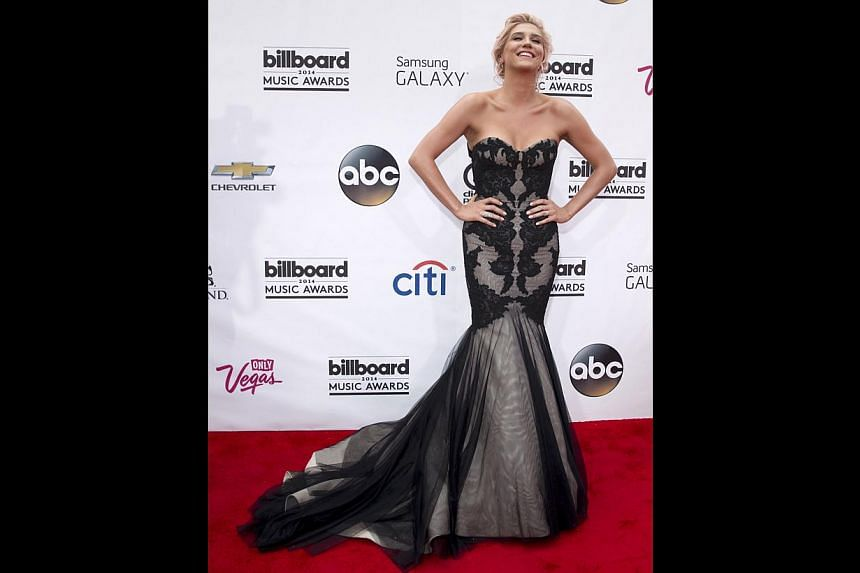 Singer Kesha channels old school glamour at the usually more relaxed awards red carpet with a black lace number with a dramatic fish tail. -- PHOTO: REUTERS