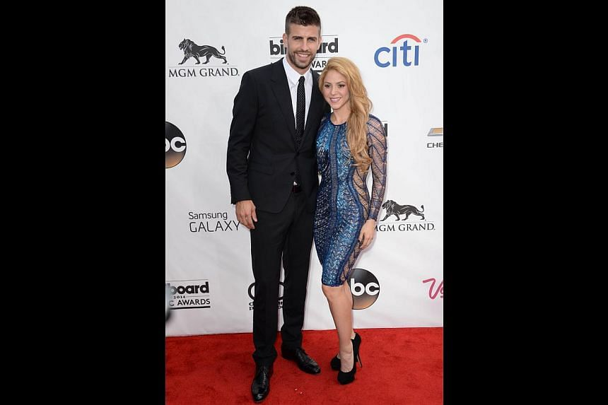 We all know Shakira is a red hot mamma, and she proves it again in this skintight sequinned number with sheer side panels. The mermaid hair goes with the dress, but the shoes are too mumsy.-- PHOTO: AFP