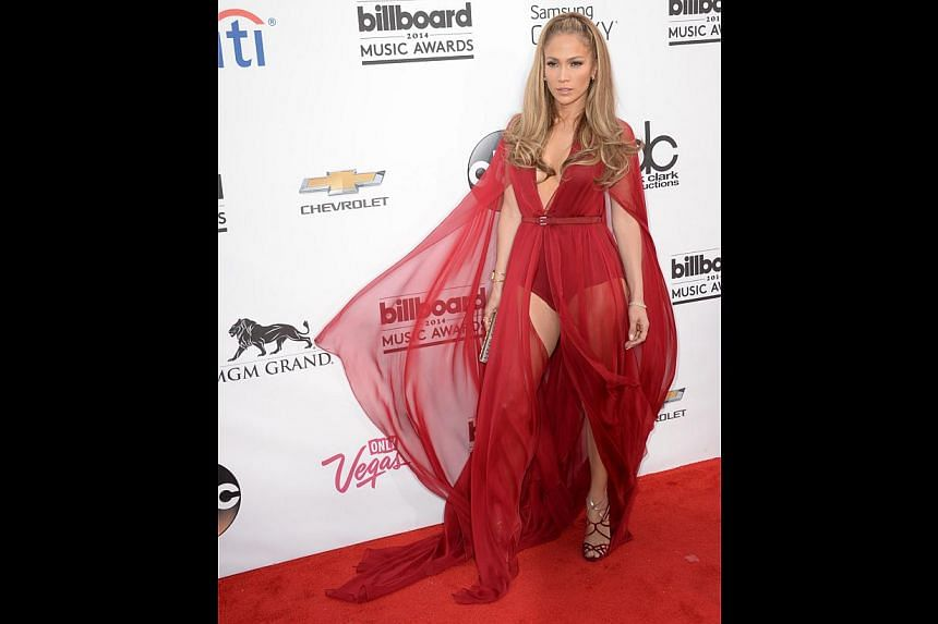 Jennifer Lopez seems to be channeling a 1960s Playgirl vibe with her high-cut bodysuit topped with a silk chiffon overlay from Donna Karan.-- PHOTO: AFP