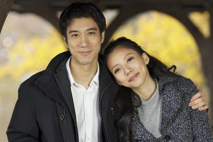 Wang Leehom with wife Li Jinglei, in a photo posted on his Facebook page. Hugging and kissing his wife of five months, pop star Wang Leehom announced at a post-concert party in Xian on Sunday that they are having a baby.  -- PHOTO: FACEBOOK