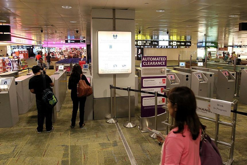 An immigration clearance checkpoint in Changi Airport. -- ST FILE PHOTO: SEAH KWANG PENG