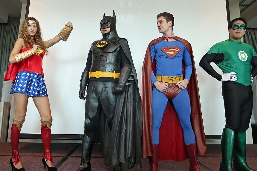 Wonder woman, Batman, Superman and Green Lantern pose for the cameras during the media session. From the end of May, visitors riding the cable cars between Mount Faber and Sentosa can fly with their favourite superheroes and take a selfie with them.&