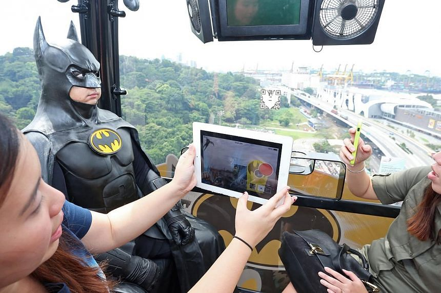 The application - Fly with superheros - provides an interactive experience for customers as they ride the cable car. From the end of May, visitors riding the cable cars between Mount Faber and Sentosa can fly with their favourite superheroes and take