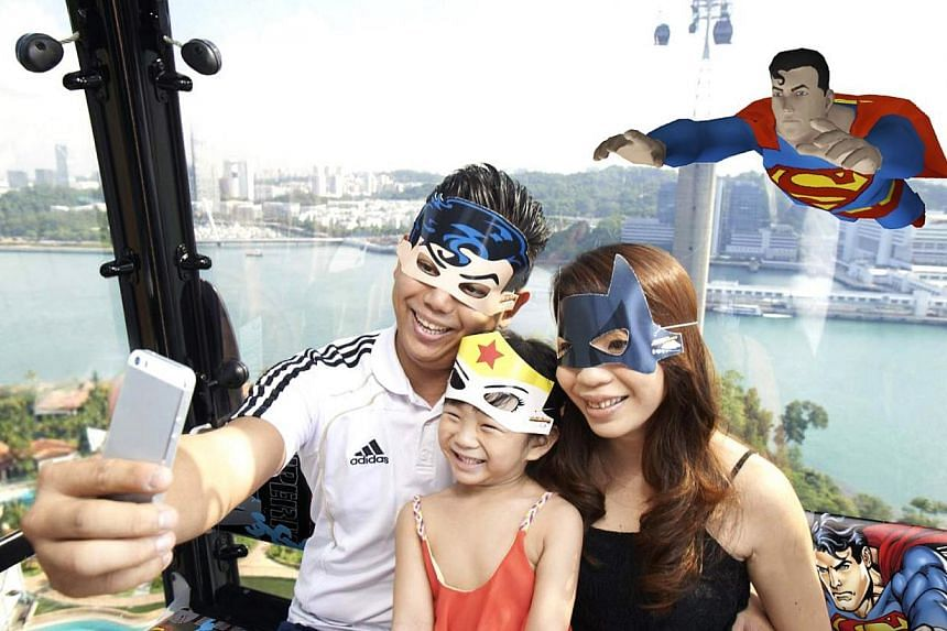 """To woo more Singaporeans on board the cable car, the company will launch a DC Super Heroes-themed campaign from May 31, where cable car riders can """"fly"""" alongside characters such as Superman and Batman in themed cabins. From the end of May, visit"""