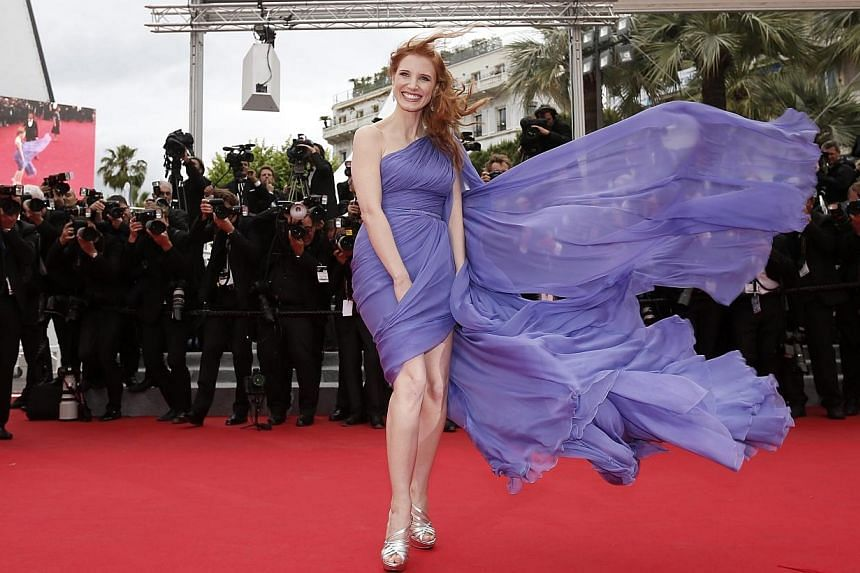 US actress Jessica Chastain arrives for the screening of Foxcatcher during the 67th Cannes Film Festival on May 19, 2014. -- PHOTO: EPA
