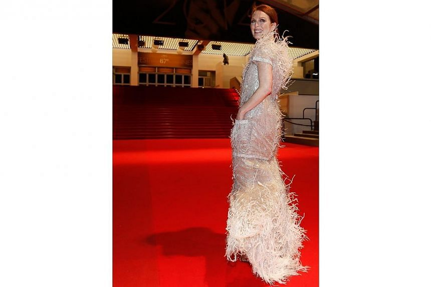 US actress Julianne Moore leaves the Festival Palace after the screening of Maps To The Stars during the 67th Cannes Film Festival on May 19, 2014. -- PHOTO: EPA