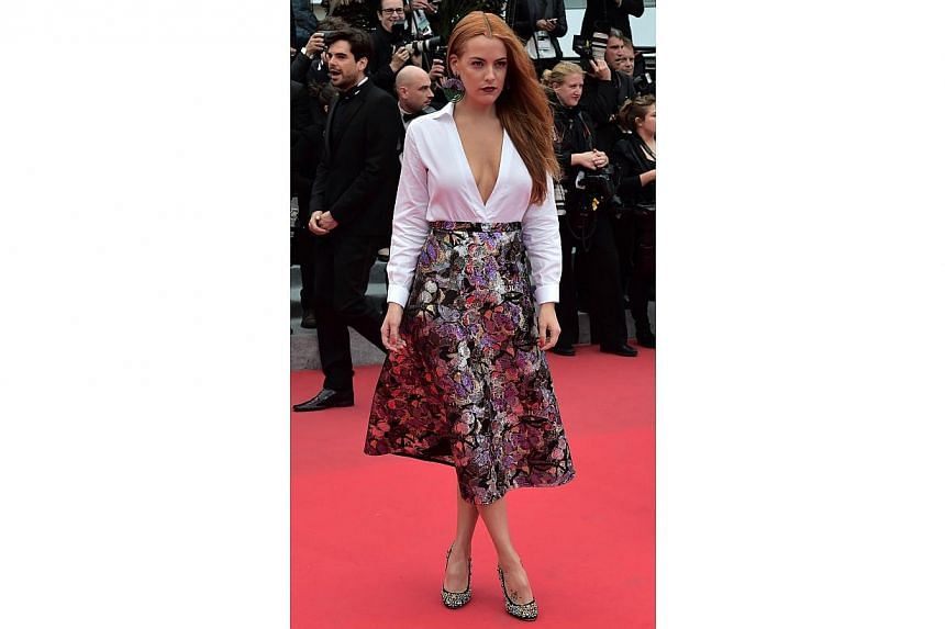 US model and actress Riley Keough arrives for the screening of Foxcatcher at the 67th Cannes Film Festival on May 19, 2014. -- PHOTO: AFP