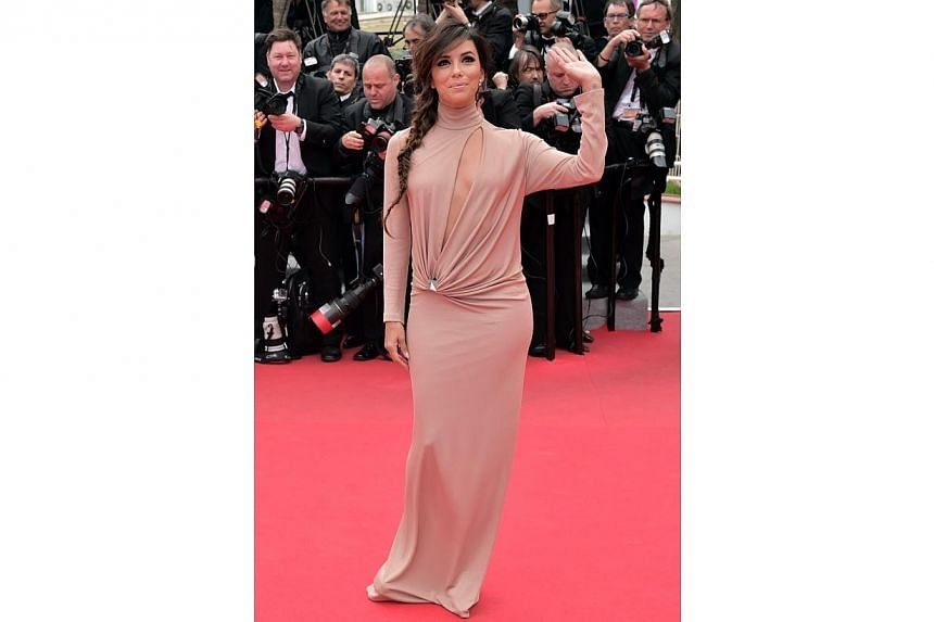 US actress and director Eva Longoria arrives for the screening of Foxcatcher at the 67th Cannes Film Festival on May 19, 2014. -- PHOTO: AFP