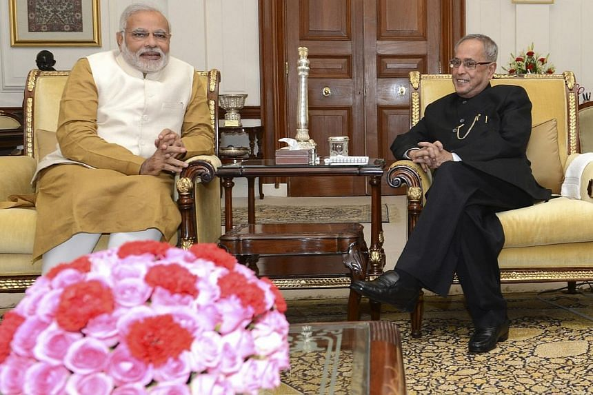 Hindu nationalist Narendra Modi (left), who will be the next prime minister of India, and India's President Pranab Mukherjee meet at India's presidential palace Rashtrapati Bhavan in New Delhi on May 20, 2014. -- PHOTO: REUTERS