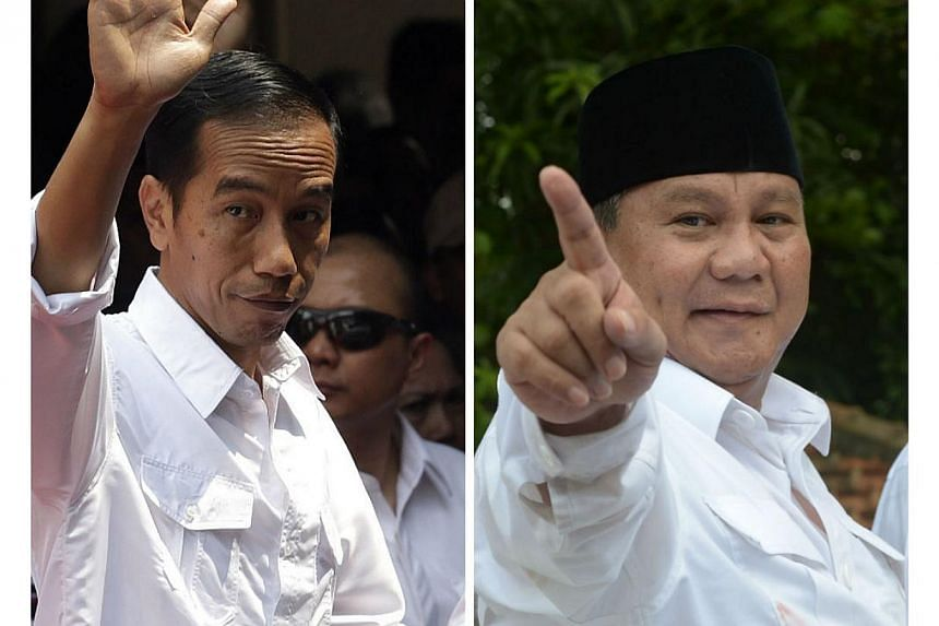 Indonesia's presidential election has developed into a two-way race between Mr Joko Widodo (left) and Mr Prabowo Subianto (right), though there are concerns that the contest will be a heated and polarising one from the onset. -- PHOTOS: EPA/AFP
