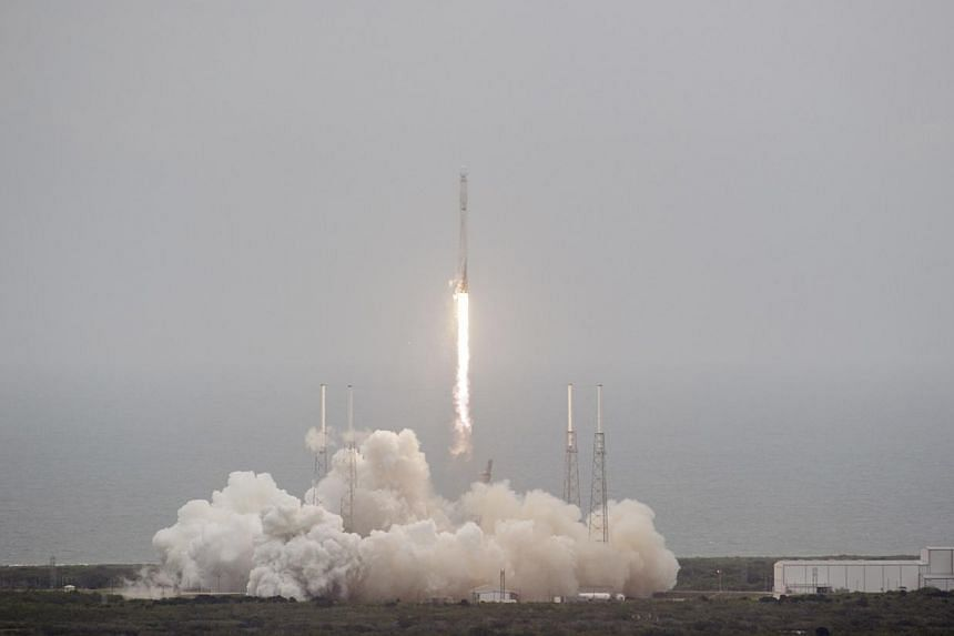 An unmanned Falcon 9 rocket blasts off from Cape Canaveral Air Force Station in this handout photo provided by NASA in Cape Canaveral, Florida April 18, 2014. Sea level rise is threatening the majority of Nasa's launch pads and multi-billion dol