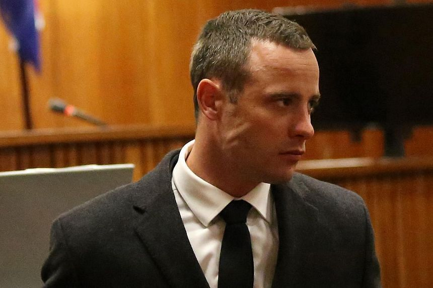 Olympic and Paralympic track star Oscar Pistorius is pictured during his murder trial at the North Gauteng High Court in Pretoria on May 20, 2014. A South African judge on Tuesday ordered Oscar Pistorius to undergo up to 30 days of psychiatric t