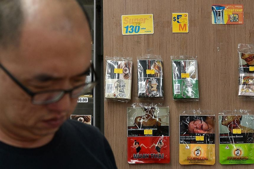 The Health Promotion Board is studying New York's recent move to increase the minimum age for cigarette purchase from 18 to 21. -- ST PHOTO: NG SOR LUAN